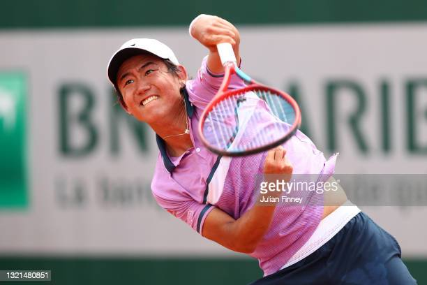 Yoshihito Nishioka of Japan serves during his mens second round match against Lorenzo Musetti of Italy during day five of the 2021 French Open at...