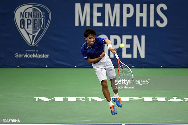 Yoshihito Nishioka of Japan serves to Sam Querrey of the United States during their quarterfinal singles match on Day 5 of the Memphis Open at the...