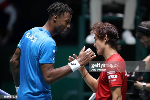 Yoshihito Nishioka of Japan shakes hands with Gael Monfils of France during Day 2 of the 2019 Davis Cup at La Caja Magica on November 19 2019 in...