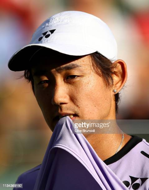 Yoshihito Nishioka of Japan shows his frustration against Denis Kudla of the United States during their men's singles first round match on day four...