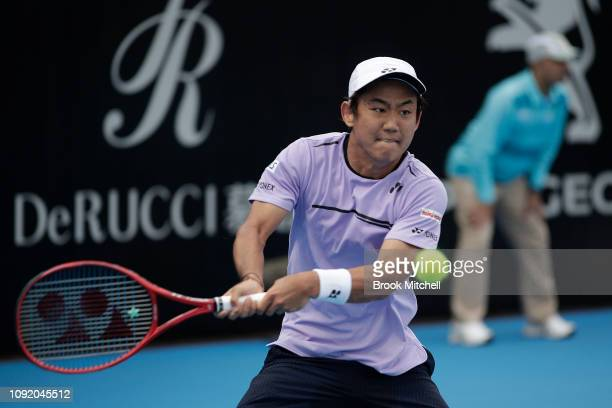 Yoshihito Nishioka of Japan strikes the ball during day five of the 2019 Sydney International at the Sydney Olympic Tennis Centre on January 10 2019...