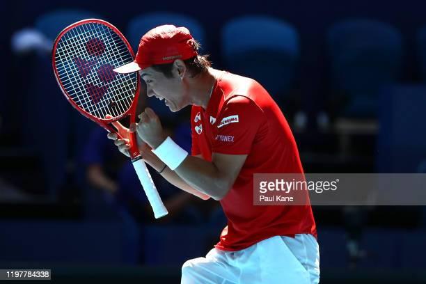 Yoshihito Nishioka of Team Japan celebrates winning his singles match against Nikoloz Basilashvili of Team Georgia during day four of the 2019 ATP...
