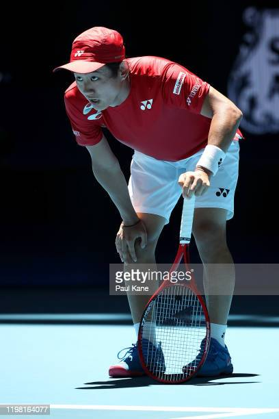Yoshihito Nishioka of Team Japan looks on after a rally against Rafael Nadal of Team Spain ay six of the 2020 ATP Cup Group Stage at RAC Arena on...