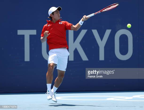 Yoshihito Nishioka of Team Japan plays a fore during his Men's Singles First Round match against Karen Khachanov of Team ROC on day two of the Tokyo...