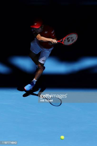 Yoshihito Nishioka of Team Japan plays a forehand to Nikoloz Basilashvili of Team Georgia during day four of the 2019 ATP Cup Group Stage at RAC...