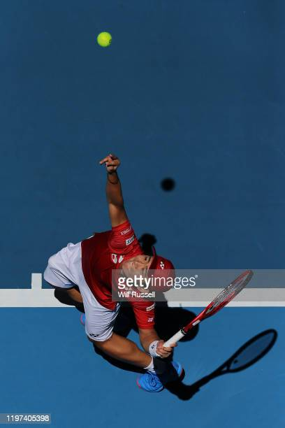 Yoshihito Nishioka of Team Japan serves to Martin Cuevas of Team Uruguay during day two of the 2020 ATP Cup Group Stage at RAC Arena on January 04...