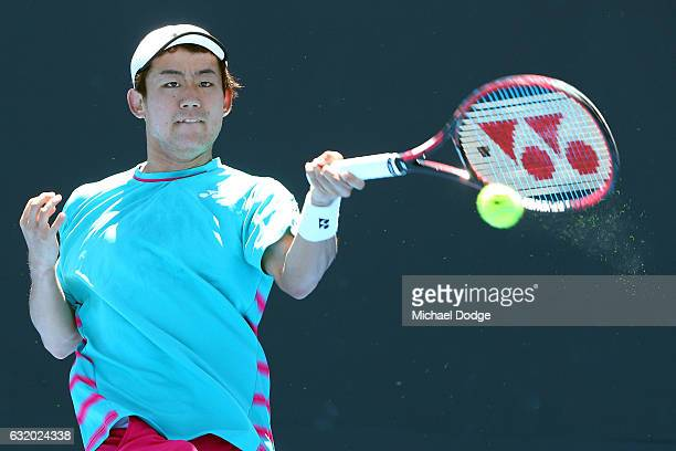 Yoshihito Nishioko of Japan hits a forehand in his second round match against Robereto Bautista Agut of Poland on day four of the 2017 Australian...