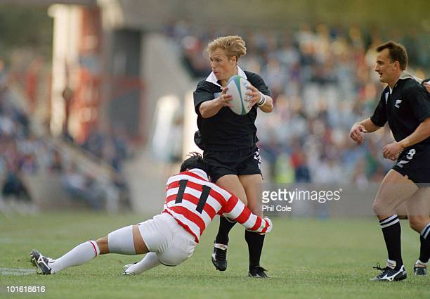 Yoshihito Yoshida tackles Jeff Wilson during the pool stage game between Japan and New Zealand at the 1995 Rugby World Cup, the Free State Stadium,...