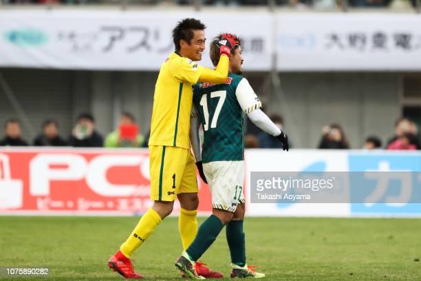 Yoshikatsu Kawaguchi and Sunao Hozaki of SC Sagamihara celebrate their 10 win in the JLeague J3 match between SC Sagamihara and Kagoshima United at...