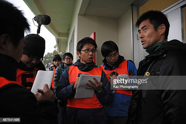 Yoshikatsu Kawaguchi of FC Gifu gives answers to the media after the preseason friendly match between FC Gifu and Fukuoka University at Beppu Jissoji...