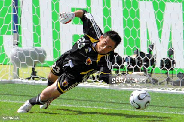 Yoshikatsu Kawaguchi of Japan dives to save the penalty kick from Darijo Srna of Croatia during the FIFA World Cup Germany 2006 Group F match between...