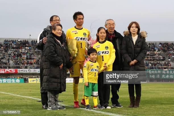 Yoshikatsu Kawaguchi of SC Sagamihara and his family members pose for photographs during his retirement ceremony following the JLeague J3 match...