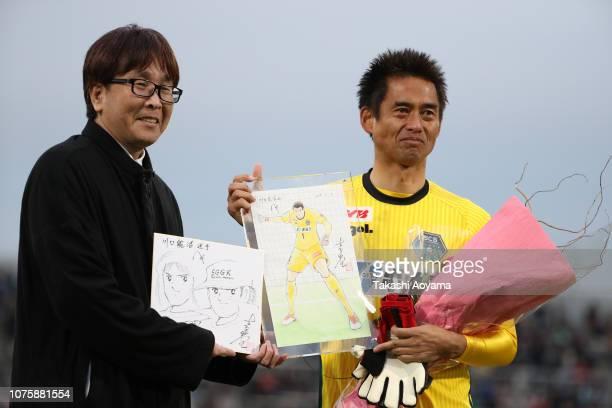 Yoshikatsu Kawaguchi of SC Sagamihara and Yoichi Takahashi author of famous soccer cartoon 'Captain Tsubasa' pose for photographs during his...