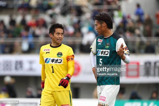 Yoshikatsu Kawaguchi of SC Sagamihara speaks with Daiki Umei during the JLeague J3 match between SC Sagamihara and Kagoshima United at Gion Stadium...