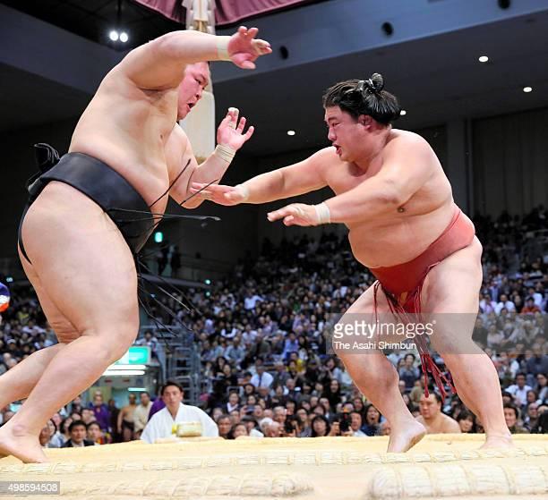 Yoshikaze pushes ozeki Goeido out of the ring to win during day fourteen of the Grand Sumo Kyushu Tournament at Fukuoka Convention Center on November...