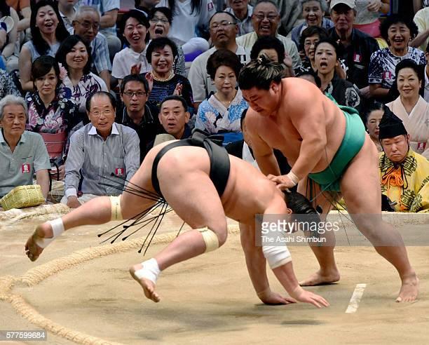 Yoshikaze throws Mongolian yokozuna Harumafuji to win during day nine of the Grand Sumo Nagoya Tournament at the Aichi Prefecture Gymnasium on July...