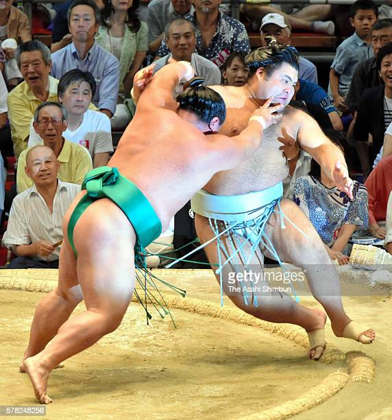 Yoshikaze throws Takayasu to win during day twelve of the Grand Sumo Nagoya Tournament at the Aichi Prefecture Gymnasium on July 21 2016 in Nagoya...