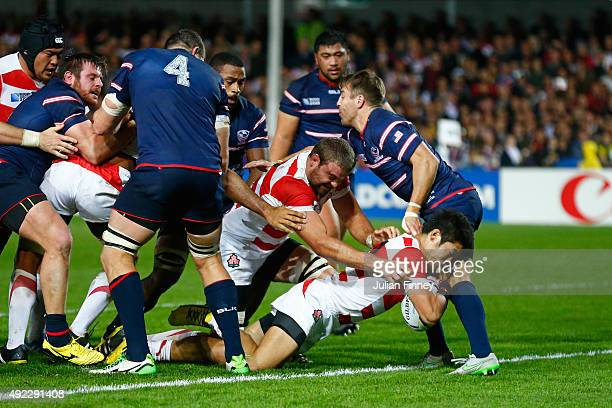 Yoshikazu Fujita of Japan scores their second try during the 2015 Rugby World Cup Pool B match between USA and Japan at Kingsholm Stadium on October...