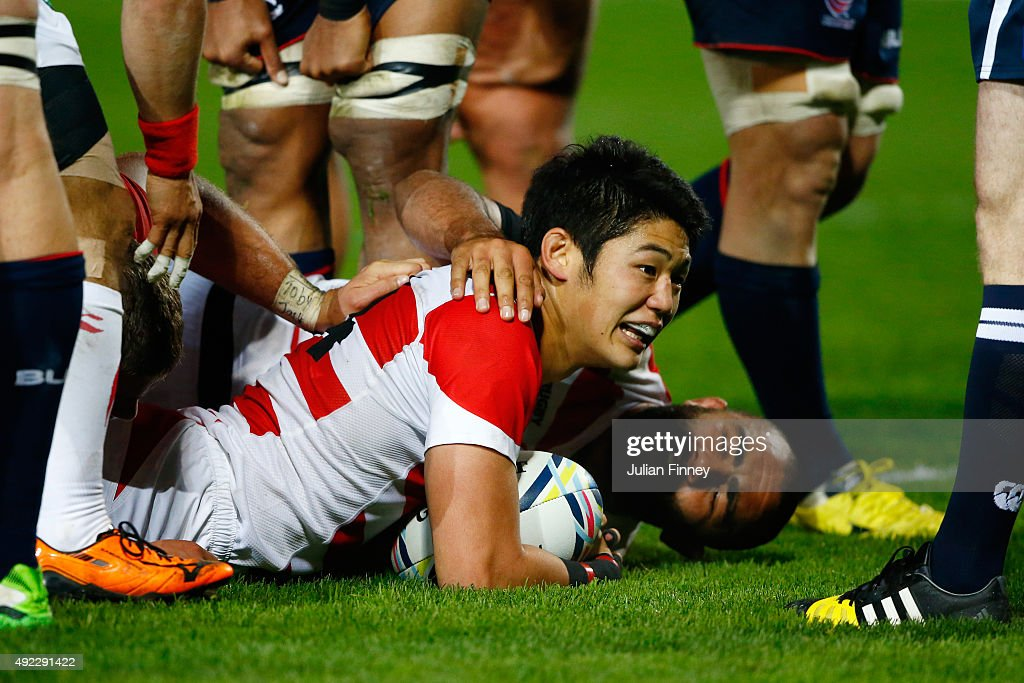 Yoshikazu Fujita of Japan scores their second try during the 2015 Rugby World Cup Pool B match between USA and Japan at Kingsholm Stadium on October 11, 2015 in Gloucester, United Kingdom.