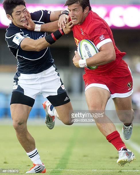 Yoshikazu Fujita of Japan struggles during a run with Daniel Tailliferrer Hauman van der Merwe of Canada during a World Rugby Pacific Nations Cup...