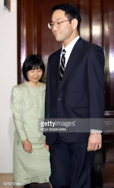 Yoshiki Kuroda , a Tokyo city bureaucrat, aged 39, and Japan's Princess Sayako arrive for a press conference regarding their engagement at the...