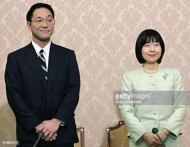 Yoshiki Kuroda , a Tokyo city bureaucrat, aged 39, and Japan's Princess Sayako stand up at the end of a press conference regarding their engagement...
