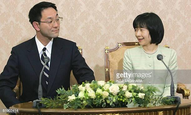 Yoshiki Kuroda , a Tokyo city bureaucrat, aged 39, and Japan's Princess Sayako look at each other during a press conference regarding their...