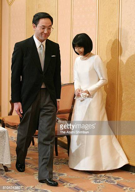 Yoshiki Kuroda and bride Sayako Kuroda leave after a press conference after their wedding ceremony at the Imperial Hotel on November 15 2005 in Tokyo...