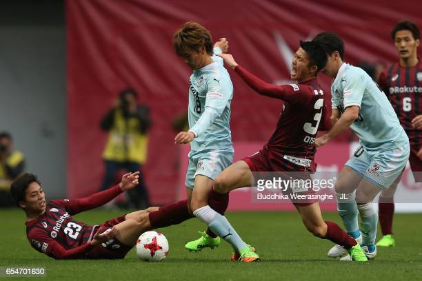 Yoshiki Matsushita and Shuhei Otsuki of Vissel Kobe compete for the ball against Koki Ogawa and Hayao Kawabe of Jubilo Iwata during the JLeague J1...