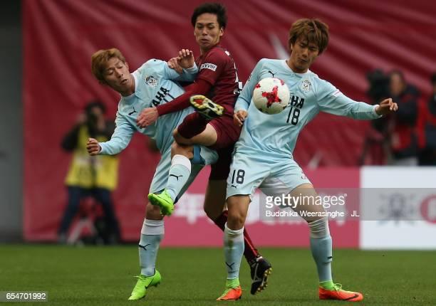 Yoshiki Matsushita of Vissel Kobe competes for the ball against Takuya Matsuura and Koki Ogawa of Jubilo Iwata during the JLeague J1 match between...