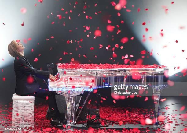 Yoshiki plays the piano on the runway by Yoshikimono during Rakuten Fashion Week TOKYO 2020 S/S on October 14, 2019 in Tokyo, Japan.
