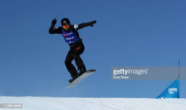 Yoshiki Takahara of Japan competes in the quarterfinals of the Men's Snowboard Cross Finals of the FIS Snowboard World Championships on February 01...