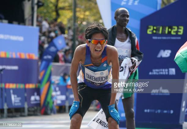 Yoshiki Takenouchi of Japan reacts after after the Professional men's Finish during the 2019 TCS New York City Marathon in New York on November 3...