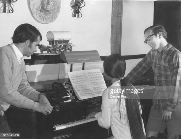 Yoshiko Shigo Tokyo Japan plays the 100 year old piano while David Currie left Royal Oak Mich and George Del Gobbo Erie Pa listen Wherever the...
