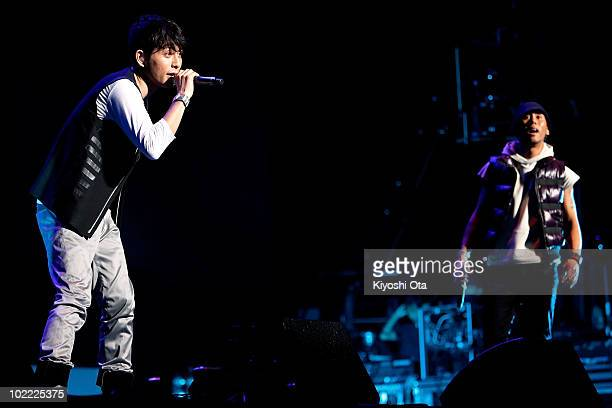 Yoshikuni Dochin and Kaname Kawabata of pop duo CHEMISTRY perform ahead of the 2010 FIFA World Cup South Africa Group E match between the Netherlands...