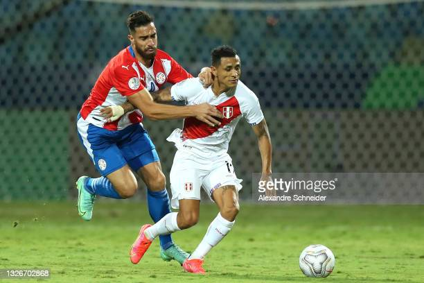 Yoshimar Yotún of Peru fights for the ball with Gabriel Avalos of Paraguay during a quarterfinal match between Peru and Paraguay as part of Copa...