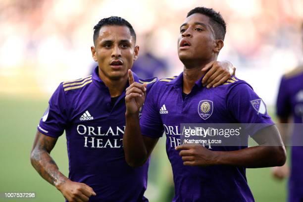 Yoshimar Yotun and Cristian Higuita of Orlando City SC celebrate a goal at StubHub Center on July 29 2018 in Carson California
