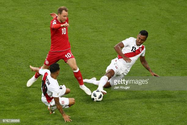 Yoshimar Yotun and Renato Tapia of Peru challenge Christian Eriksen of Denmark during the 2018 FIFA World Cup Russia group C match between Peru and...