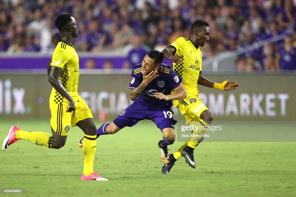Yoshimar Yotun #19 of Orlando City SC gets fouled by Harrison Afful #25 of Columbus Crew SC during a MLS soccer match between the Columbus Crew SC and the Orlando City SC at Orlando City Stadium on August 19, 2017 in Orlando, Florida.