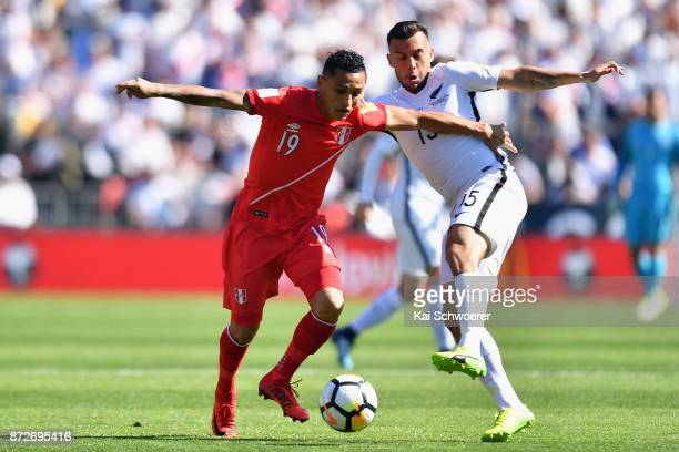Yoshimar Yotun of Peru controls the ball from Clayton Lewis of the All Whites during the 2018 FIFA World Cup Qualifier match between the New Zealand...