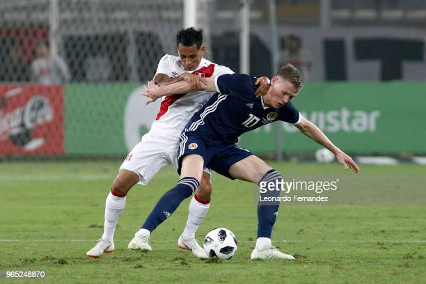 Yoshimar Yotun of Peru fights for the ball against Scott McTominay of Scotland during the international friendly match between Peru and Scotland at...
