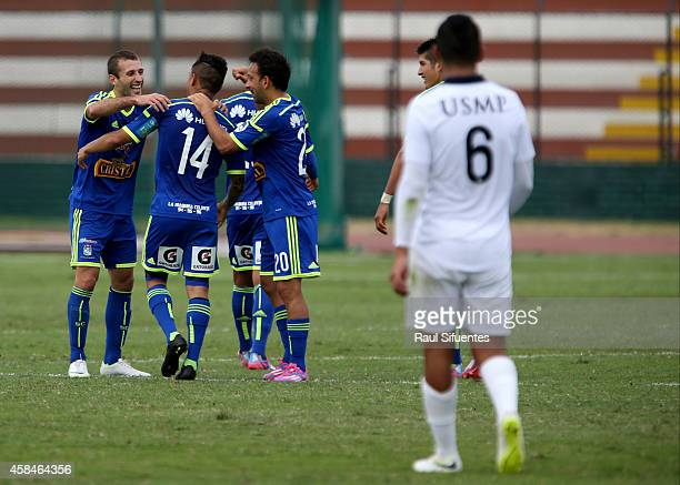 Yoshimar Yotun of Sporting Cristal celebrates with teammates after scoring the first goal of his team against San Martin during a match between San...