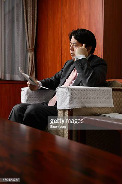 Yoshimasa Hayashi Japan's minister of agriculture forestry and fisheries looks at a document following an interview in Tokyo Japan on Monday April 20...