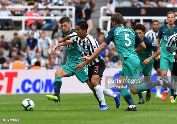 Yoshimori Muto of Newcastle United is tackled by Ben Davies and Jan Vertonghen of Tottenham Hotspur during the Premier League match between Newcastle...