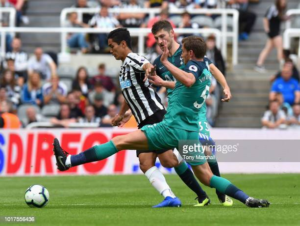 Yoshimori Muto of Newcastle United is tackled by Jan Vertonghen of Tottenham Hotspur during the Premier League match between Newcastle United and...