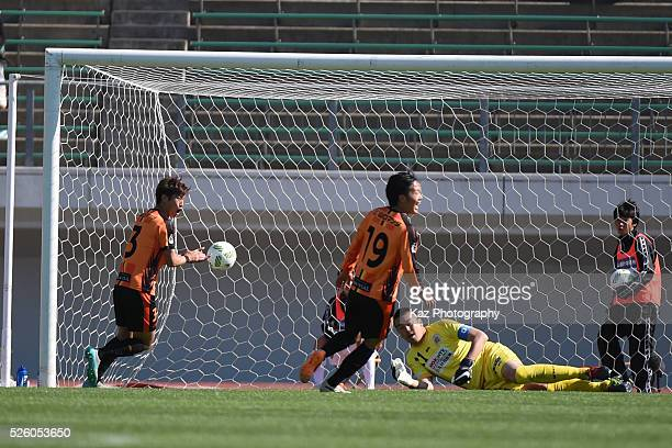 Yoshinari Takagi of FC Gifu has been beaten by Fumitaka Kitatani of Renofa Yamaguchi during the JLeague match between FC Gifu and Renofa Yamaguchi at...