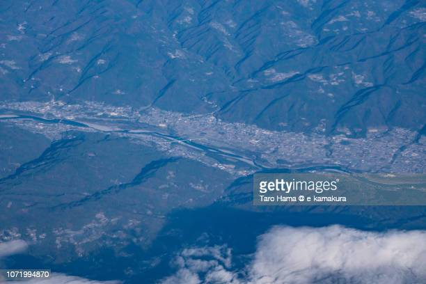 Yoshino River and Higashimiyoshi town in Tokushima prefecture in Japan daytime aerial view from airplane