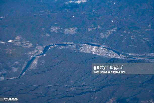 Yoshino River and Miyoshi city in Tokushima prefecture in Japan daytime aerial view from airplane
