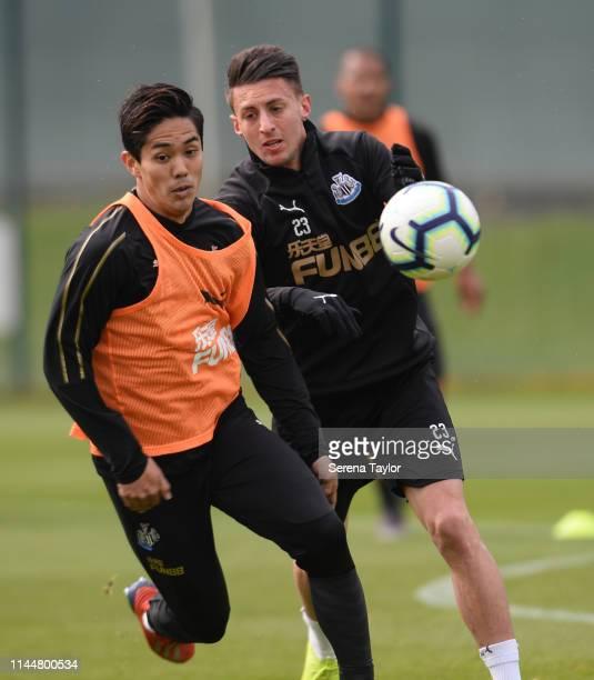 Yoshinori Muto and Antonio Barreca jostle for the ball during the Newcastle United Training Session at the Newcastle United Training Centre on April...