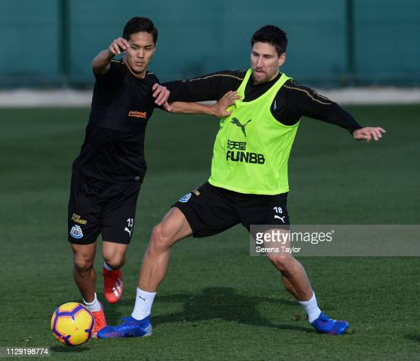Yoshinori Muto and Federico Fernandez jostle for the ball during the Newcastle United warm weather training session at La Finca Golf Resort on...